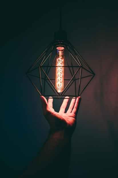 person holding pendant light
